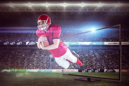 scoring: American football player scoring a touchdown against rugby stadium