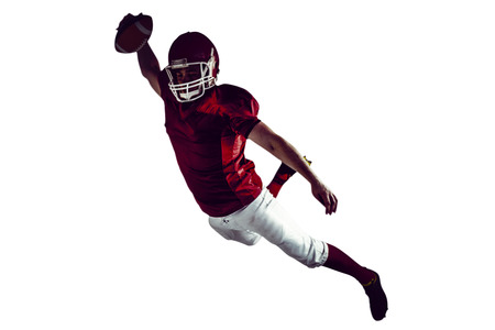 scoring: American football player scoring a touchdown on a white background