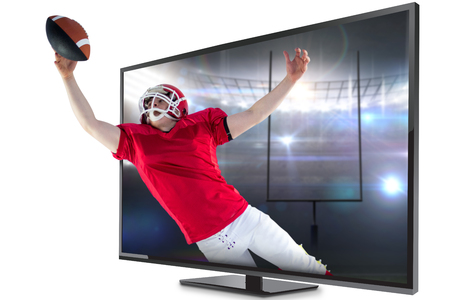 flat screen: American football player scoring a touchdown against american football arena