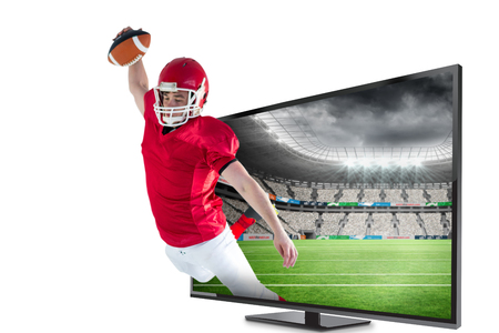 flat screen: American football player scoring a touchdown against rugby stadium