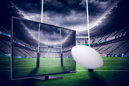 pelota rugby: pelota de rugby contra el estadio de rugby