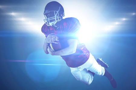 touchdown: American football player scoring a touchdown against spotlights Stock Photo