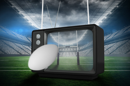 old fashioned tv: rugby ball against rugby stadium Stock Photo