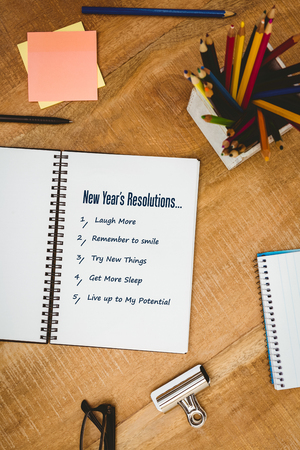 resolutions: New years resolutions against close up view of business stuff