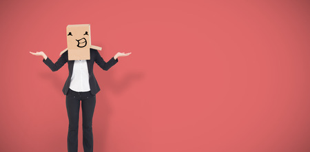 well dressed woman: Businesswoman with box over head against red vignette