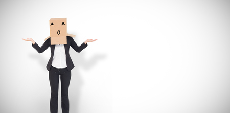 well dressed woman: Businesswoman with box over head against white background with vignette