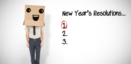 new years resolutions: Businessman standing with box on head  against white background with vignette