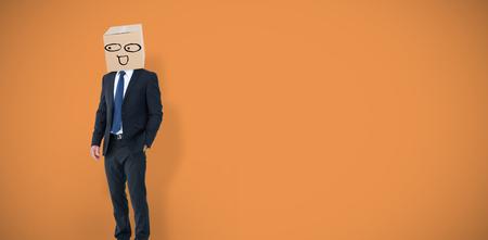 well dressed: Anonymous businessman against orange vignette