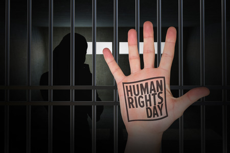 lady silhouette: Hand with fingers spread out against human rights Stock Photo