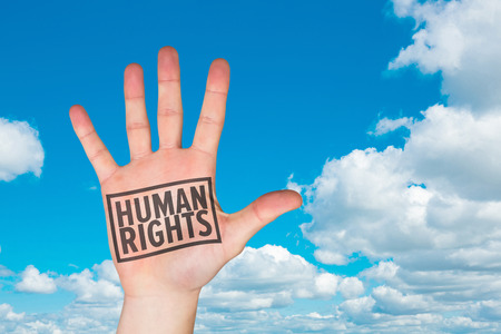 human hands: Hand with fingers spread out against scenic view of blue sky Stock Photo