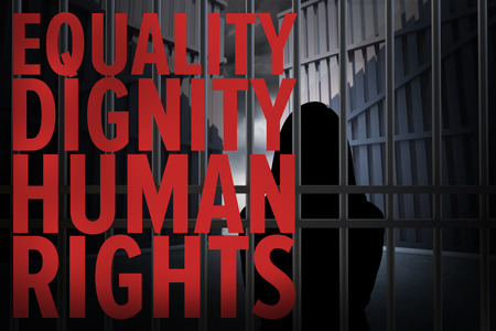behind bars: Abstract image of silhouette standing woman  against human rights Stock Photo