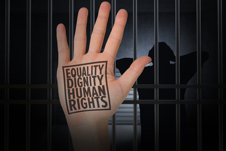 interned: Hand with fingers spread out against human rights Stock Photo