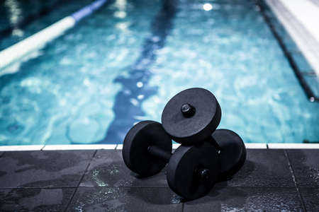 leisure centre: Foam dumbbells beside the pool at the leisure centre