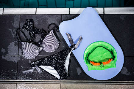 swimming to float: Bikini and swimming float by the pool at the leisure centre
