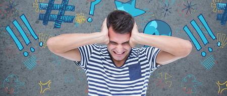 dirty old man: Frustrated man covering ears against dirty old wall background Stock Photo