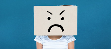 apprehensive: Depressed woman with box over head against blue background