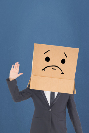 anonymous: Anonymous businessman against blue background Stock Photo