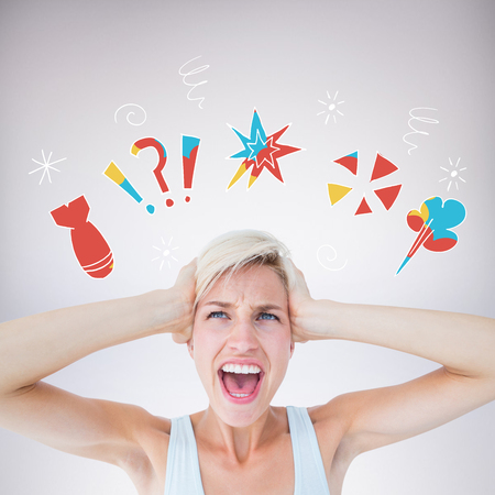angry blonde: Angry blonde screaming and holding her head  against grey background