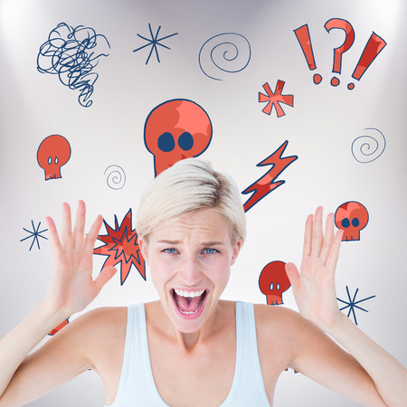 angry blonde: Angry blonde screaming with hands up  against grey background Stock Photo