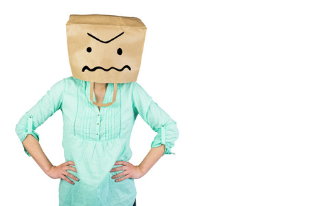 obscured face: Woman with hands on hip and covering head with brown paper bag  against white background with vignette