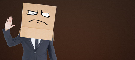 anonymous: Anonymous businessman against dark brown background