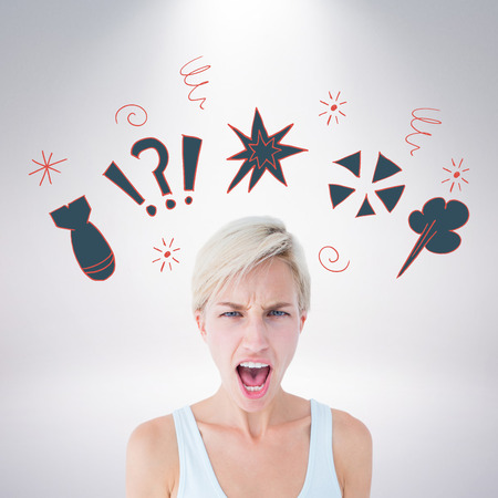 angry blonde: Angry blonde woman screaming  against grey background