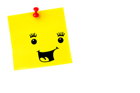 yellow pushpin: Smiling face against illustrative image of pushpin on yellow paper