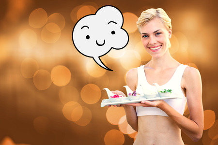 herbal medicine: Happy blonde woman holding plate with herbal medicine against glowing background