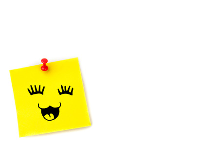 adhesive note: Smiling face against pinned adhesive note Stock Photo