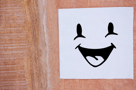 smile close up: Smiling face against view of tissue on desk