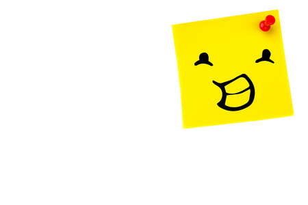 yellow pushpin: Smiling face against digital image of pushpin on yellow paper Stock Photo