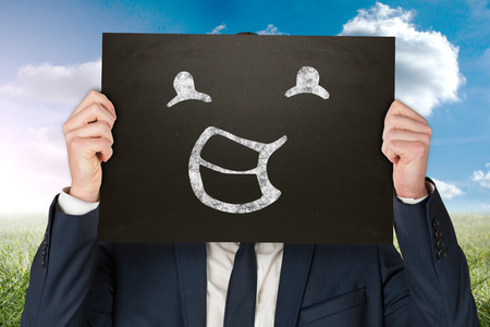 sophisticate: Businessman holding board against blue sky over wooden floor
