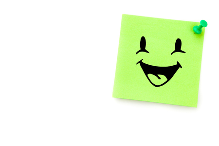 adhesive note: Smiling face against green adhesive note