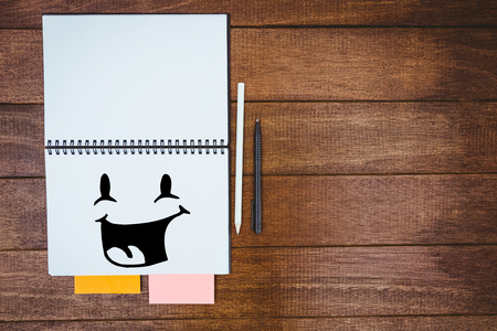 workbook: Smiling face against close up view of a workbook Stock Photo