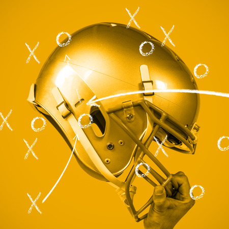 sliver: American football player handing his sliver helmet against yellow background with vignette
