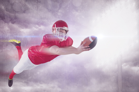touchdown: American football player scoring a touchdown against spotlight in the sky Stock Photo