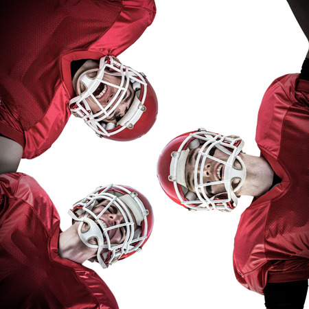 huddle: American football huddle against white background with vignette