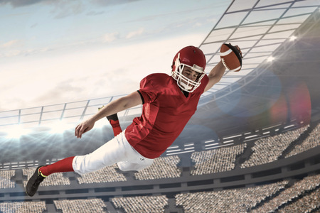 touchdown: American football player scoring a touchdown against stadium Stock Photo