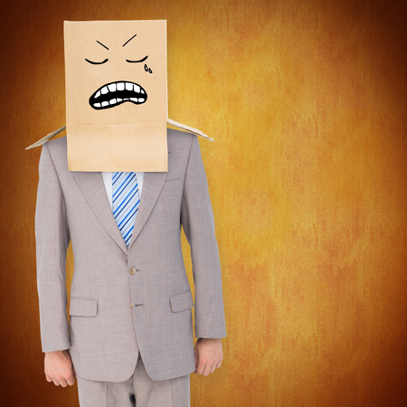 anonymous: Anonymous businessman against orange background