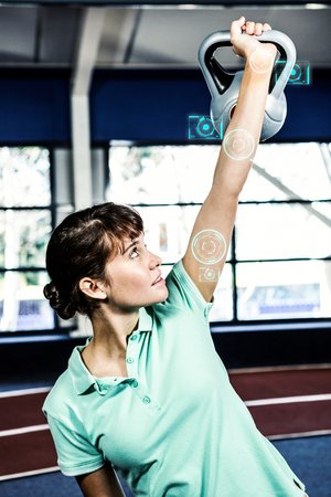 working out: Woman working out in gym against fitness interface