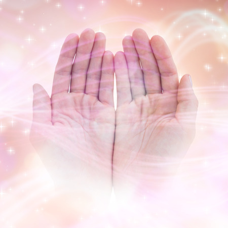 glimmering: Woman presenting with her hands against glowing background Stock Photo