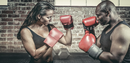 fighting stance: Athletes with fighting stance against gym
