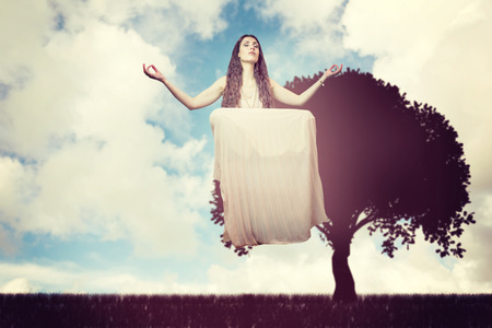 levitating: Portrait of woman levitating with eyes closed  against blue sky with white clouds