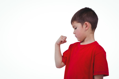 frowned: Boy looking at his biceps on white screen