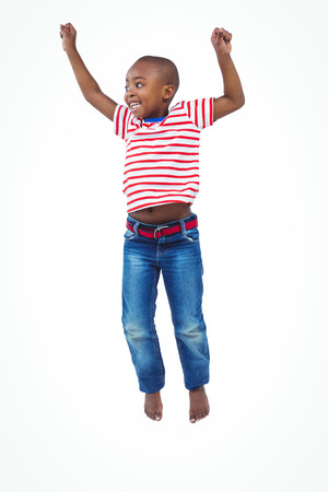 barefoot people: Smiling boy jumping on white screen Stock Photo