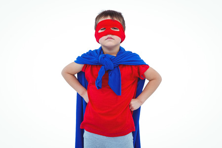 pretending: Masked boy pretending to be superhero on white screen