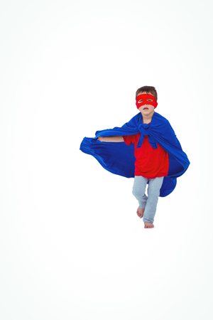pretending: Masked boy running pretending to be superhero on white screen