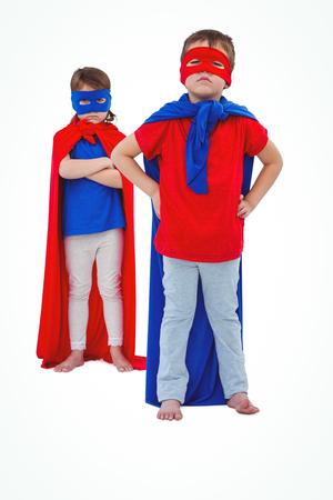 superheroes: Masked kids pretending to be superheroes on white screen Stock Photo