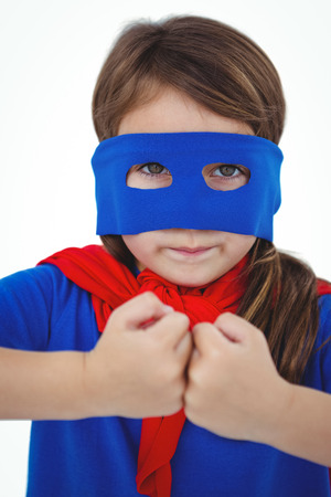 pretending: Masked girl pretending to be superhero showing fist-to-fist on white screen Stock Photo