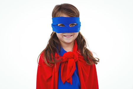 pretending: Masked girl pretending to be superhero smiling at the camera on white screen